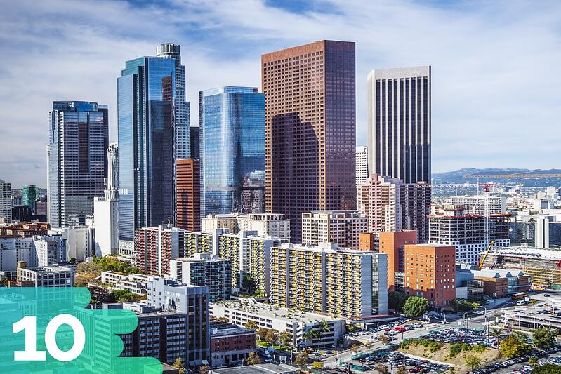 Downtown Los Angeles featuring a variety of office buildings and skyscrapers together with mountains in the distance.
